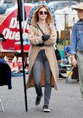Lucy Hale steps out in a beige trench coat while shopping at a local flea market in Los Angeles