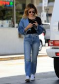 Lucy Hale stops at a gas station to fill up her Mercedes G Wagon while out in Los Angeles