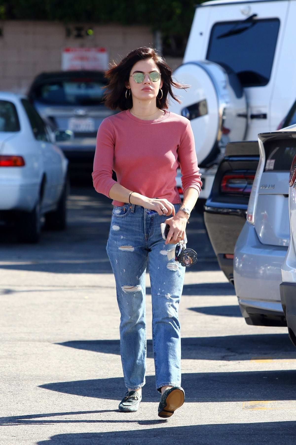 Lucy Hale stops by Starbucks to pick up an iced coffee and an iced tea while out in Studio City, Los Angeles