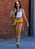 Madison Beer rocks a white cropped tank top and denim shorts while out with her pup and a friend in West Hollywood, Los Angeles