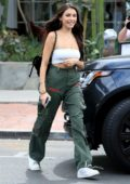 Madison Beer seen out and about in a white tube top and green cargos in West Hollywood, Los Angeles