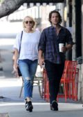 Malin Akerman hold hands with boyfriend Jack Donnelly while out in Los Feliz, California