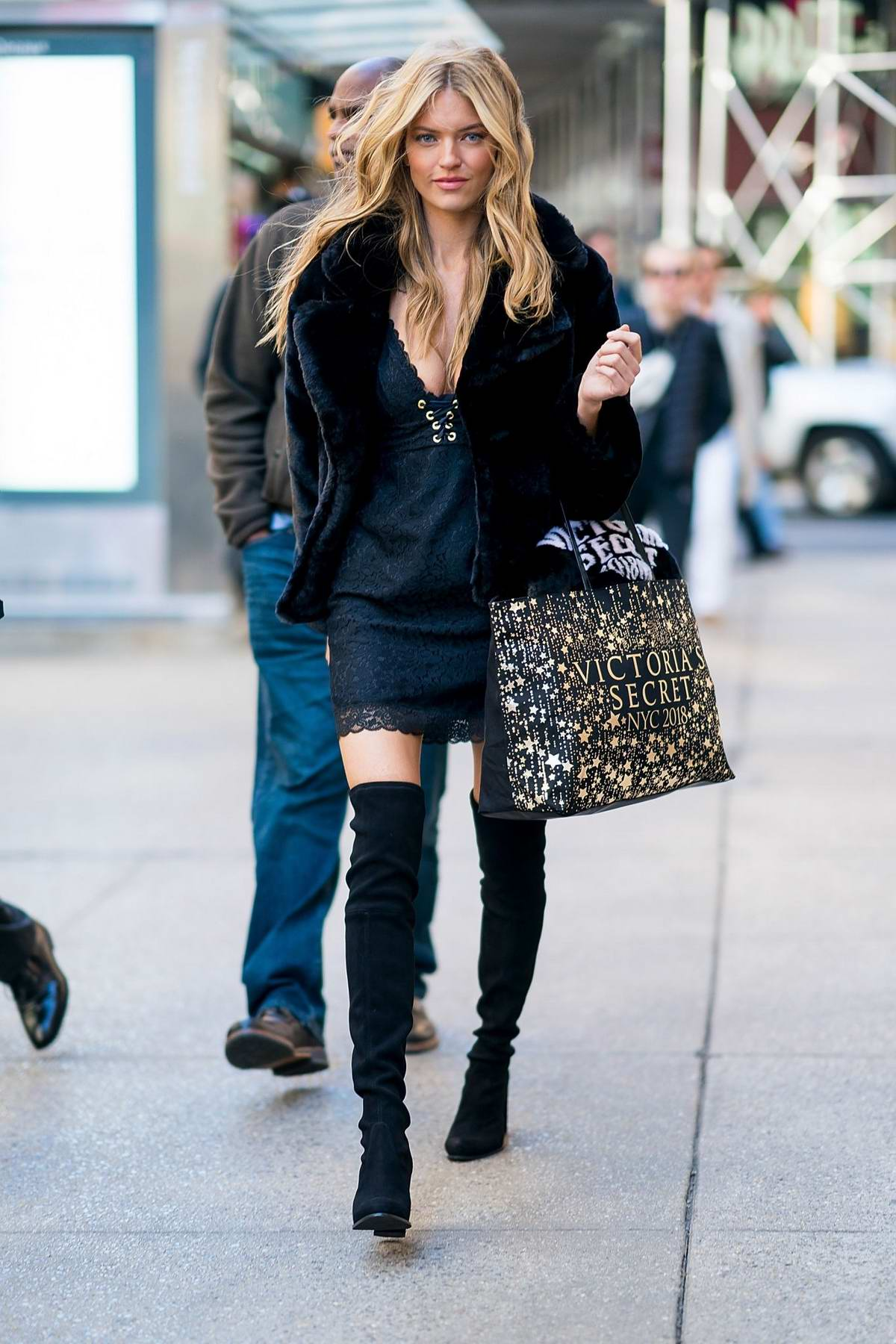 Martha Hunts rocks black fur jacket over a short black dress with thigh high boots as she arrive for her fittings at the Victoria's Secret offices in New York City