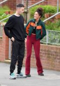 Michelle Keegan dons a green and orange jacket and maroon corduroy pants while filming TV show 'Brassic' in Manchester, UK