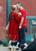 Michelle Williams and Phil Elverum share a kiss as they step out wearing matching red outfits in Brooklyn, New York City