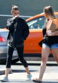 Mila Kunis wears a black jacket and leggings to lunch with a friend in Los Angeles