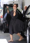 Minka Kelly is all smiles as she steps out in a black polka dot dress in Beverly Hills, Los Angeles
