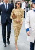 Nina Dobrev looks pretty in a long patterned dress as she steps out in Paris, France