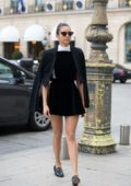 Nina Dobrev wears a black minidress while strolling with her mom around Place Vendome in Paris, France