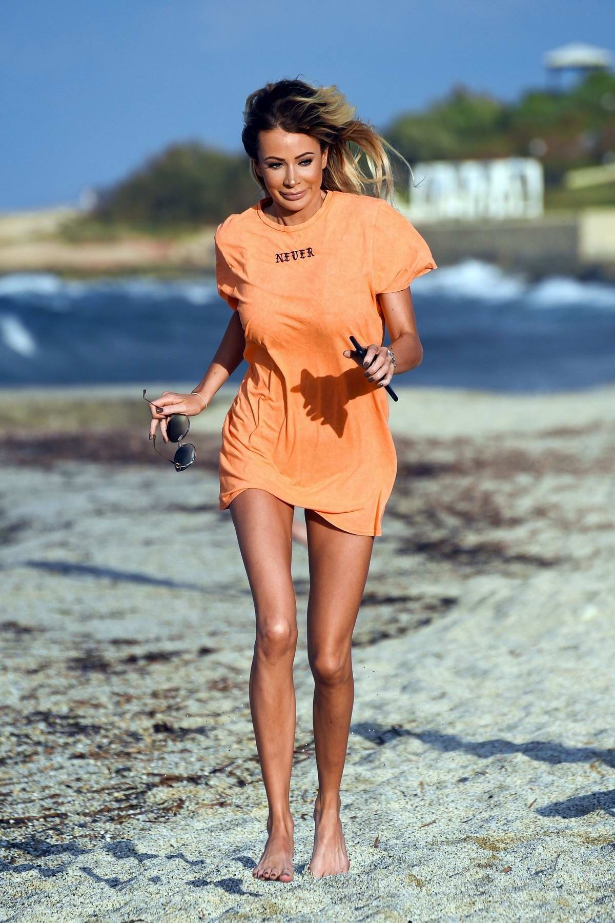 Olivia Attwood spotted in an orange t-shirt as she enjoys the beach in Greece