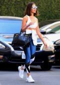 Olivia Culpo steps out in a white sports bra and leggings paired with white trainers while heading to a dermatology clinic in Beverly Hills, Los Angeles