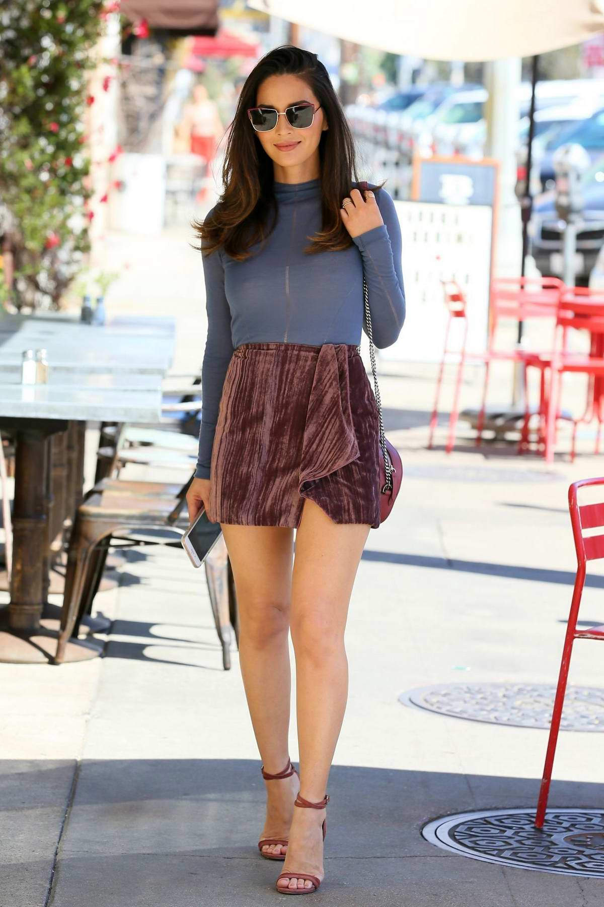 Olivia Munn looks stunning in a miniskirt and pastel blue top while out in Los Angeles
