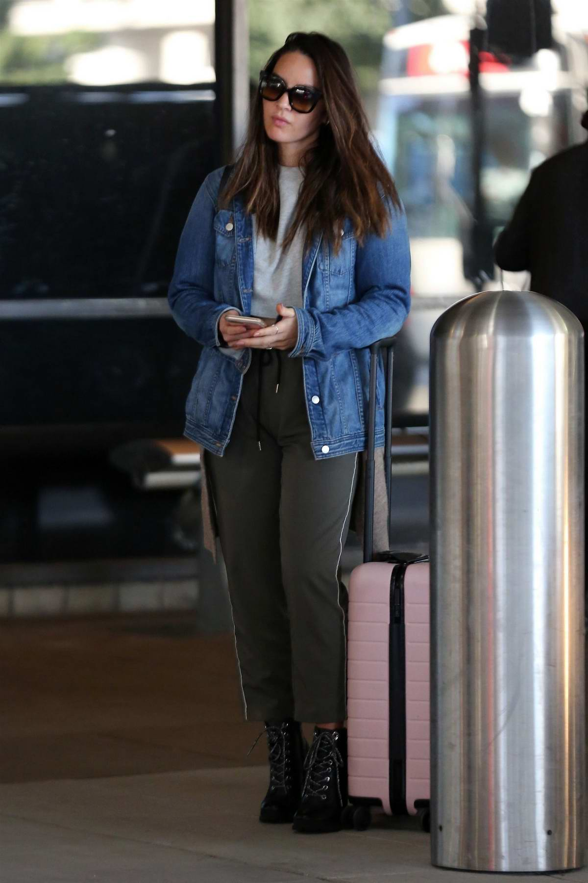 Olivia Munn spotted while waiting for her ride outside LAX airport in Los Angeles