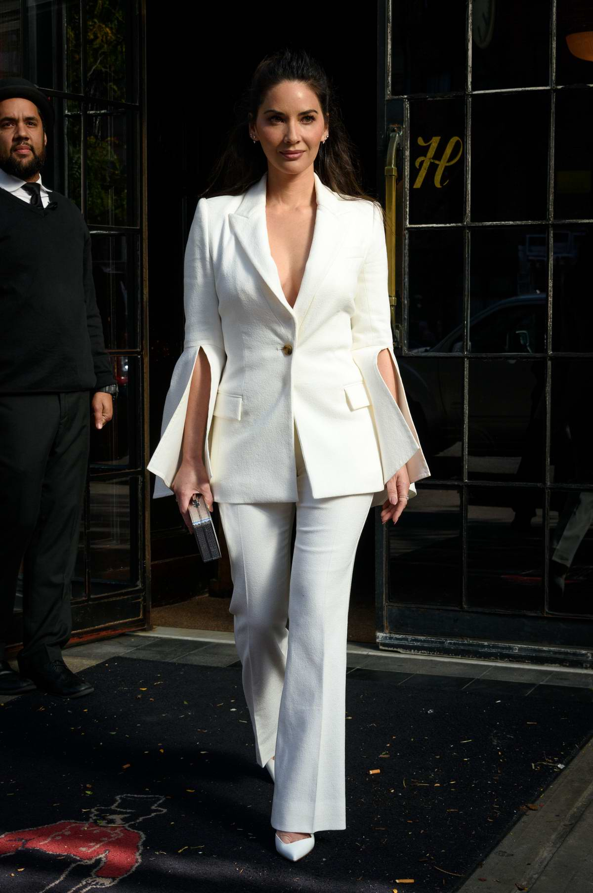 Olivia Munn wears a white pantsuit as she leaves the Bowery Hotel in New York City