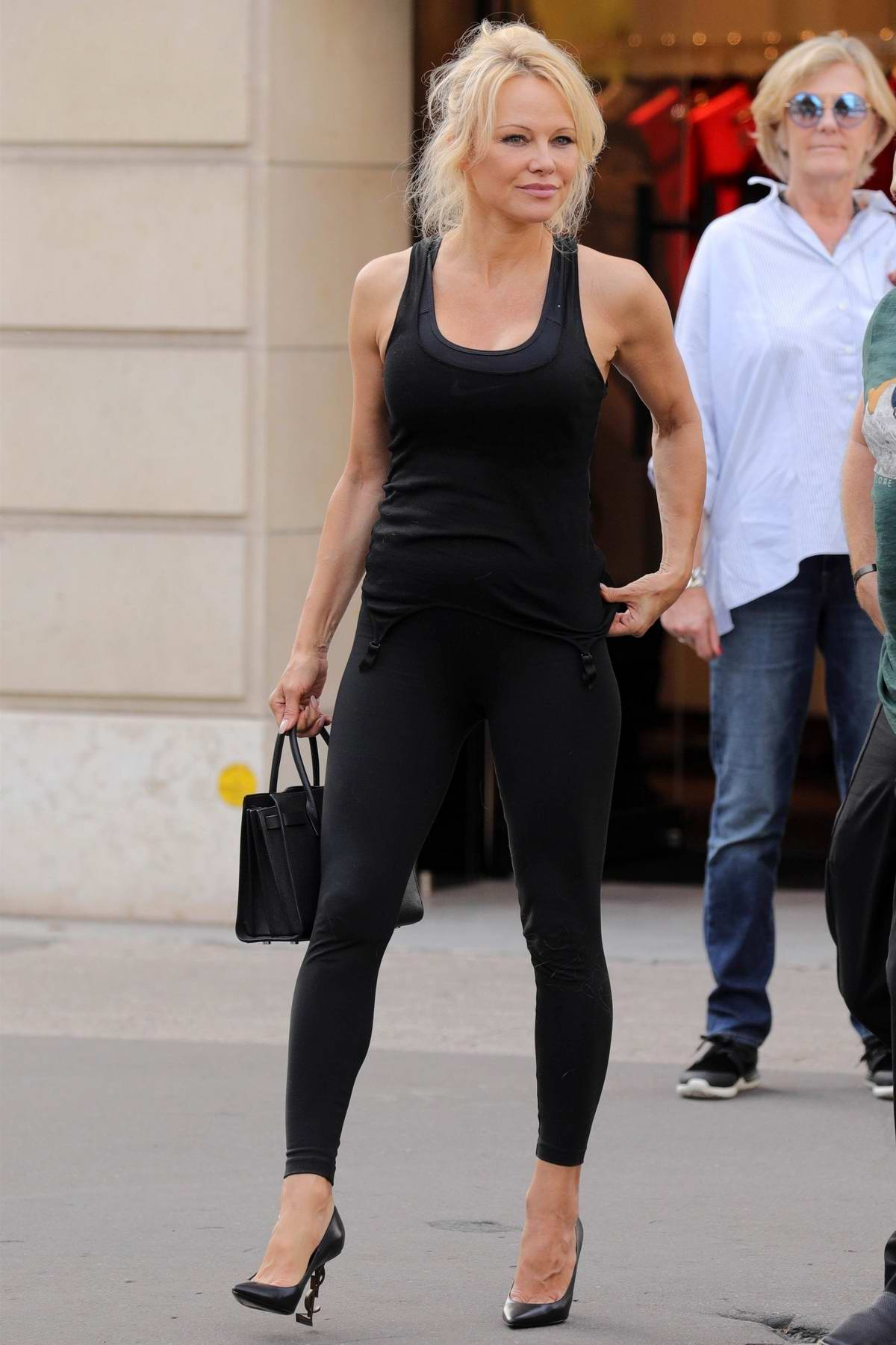 Pamela Anderson spotted while shopping at Balenciaga with her dog in Paris, France