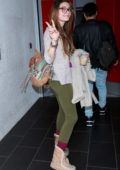 Paris Jackson flashes the peace sign as she arrives at LAX to catch a flight out of Los Angeles