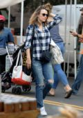 Rachel McAdams picks up some produce and flowers at the farmers market in Los Angeles