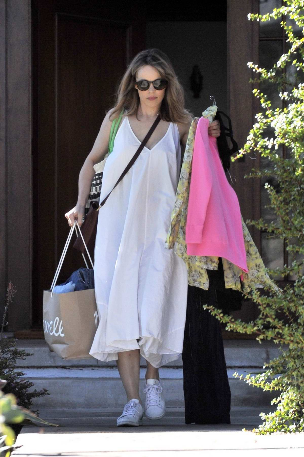 Rachel Mcadams Spotted Carrying Ping Bags And Clothes As She Heads Out Wearing A White Sundress Sneakers In Los Angeles