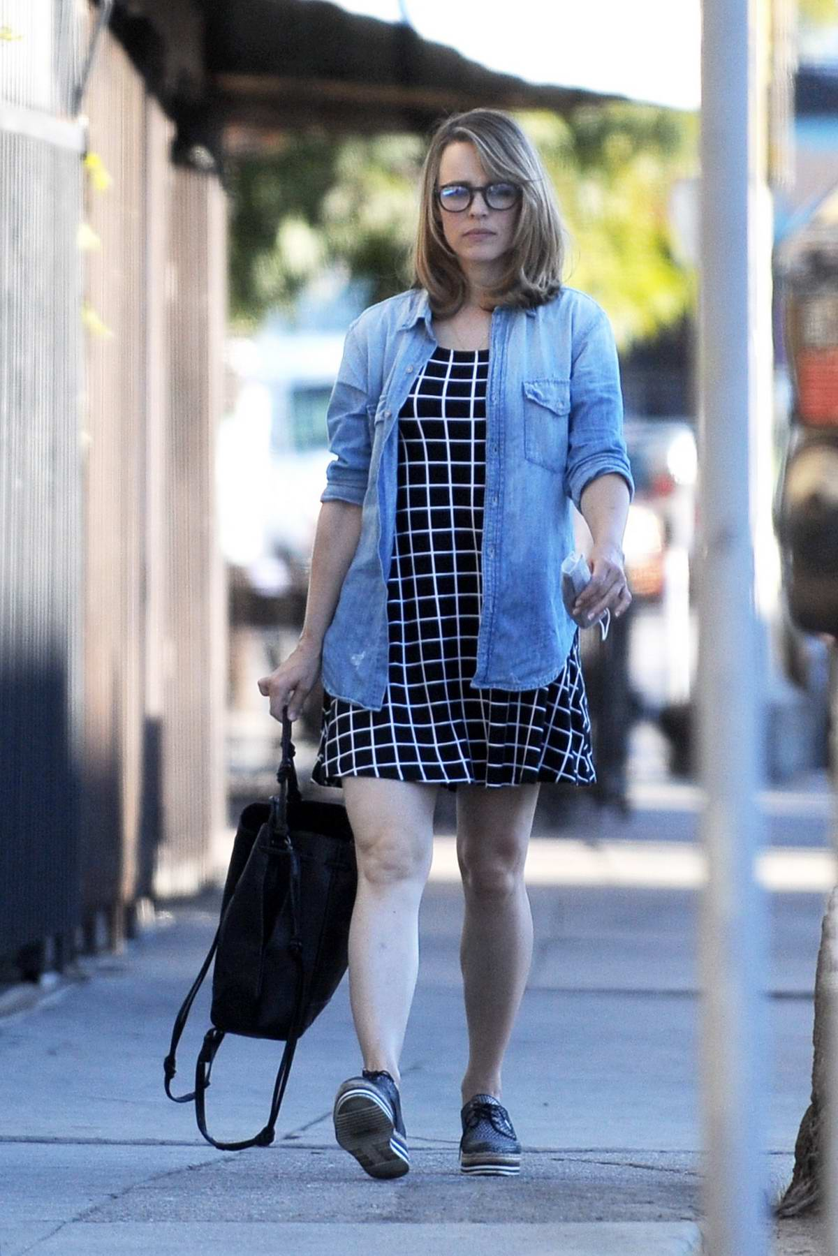 Rachel McAdams wears a black and white checkered dress with a denim shirt while out for lunch at Silverlake Ramen in Los Angeles