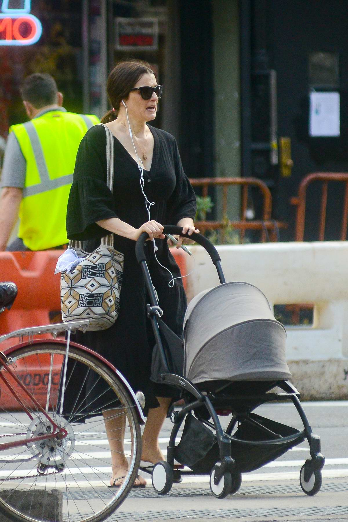 Rachel Weisz steps out in a black dress with her baby stroller in New York City