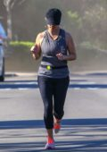 Reese Witherspoon spotted in a grey tank top, leggings and baseball cap while out jogging in Santa Monica, California