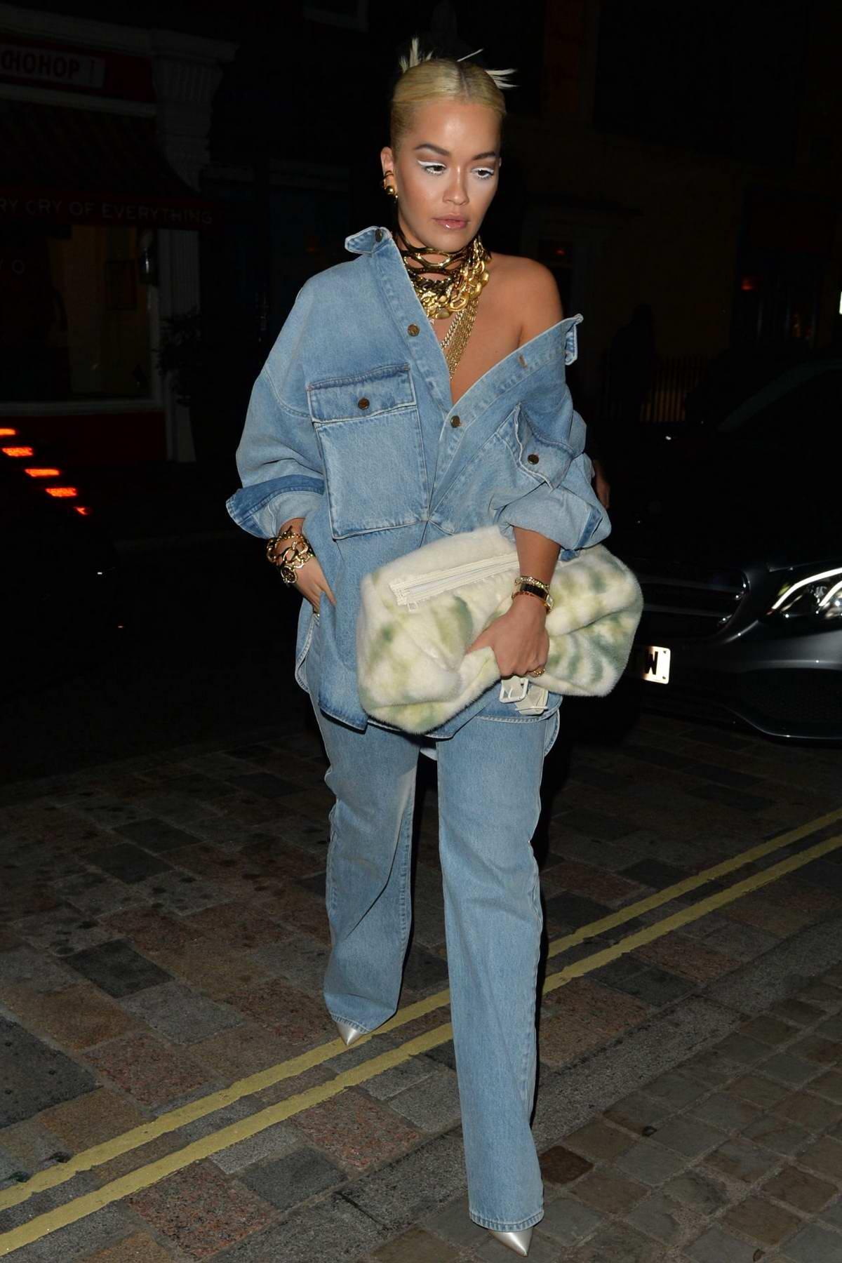 Rita Ora rocks double denim as she arrives at Chiltern Firehouse in London, UK