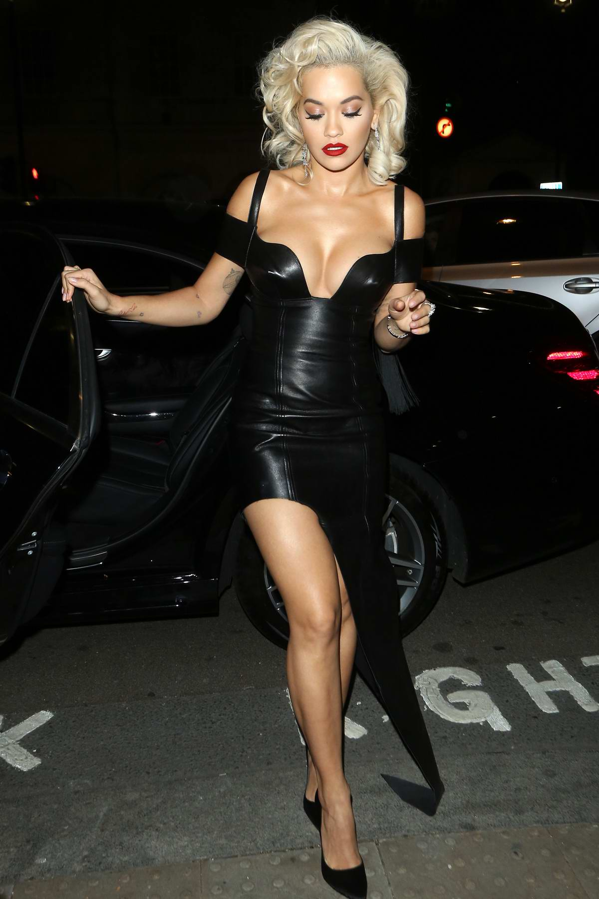 Rita Ora seen arriving in a plunging black dress as she attends the UNICEF Halloween Ball in London, UK