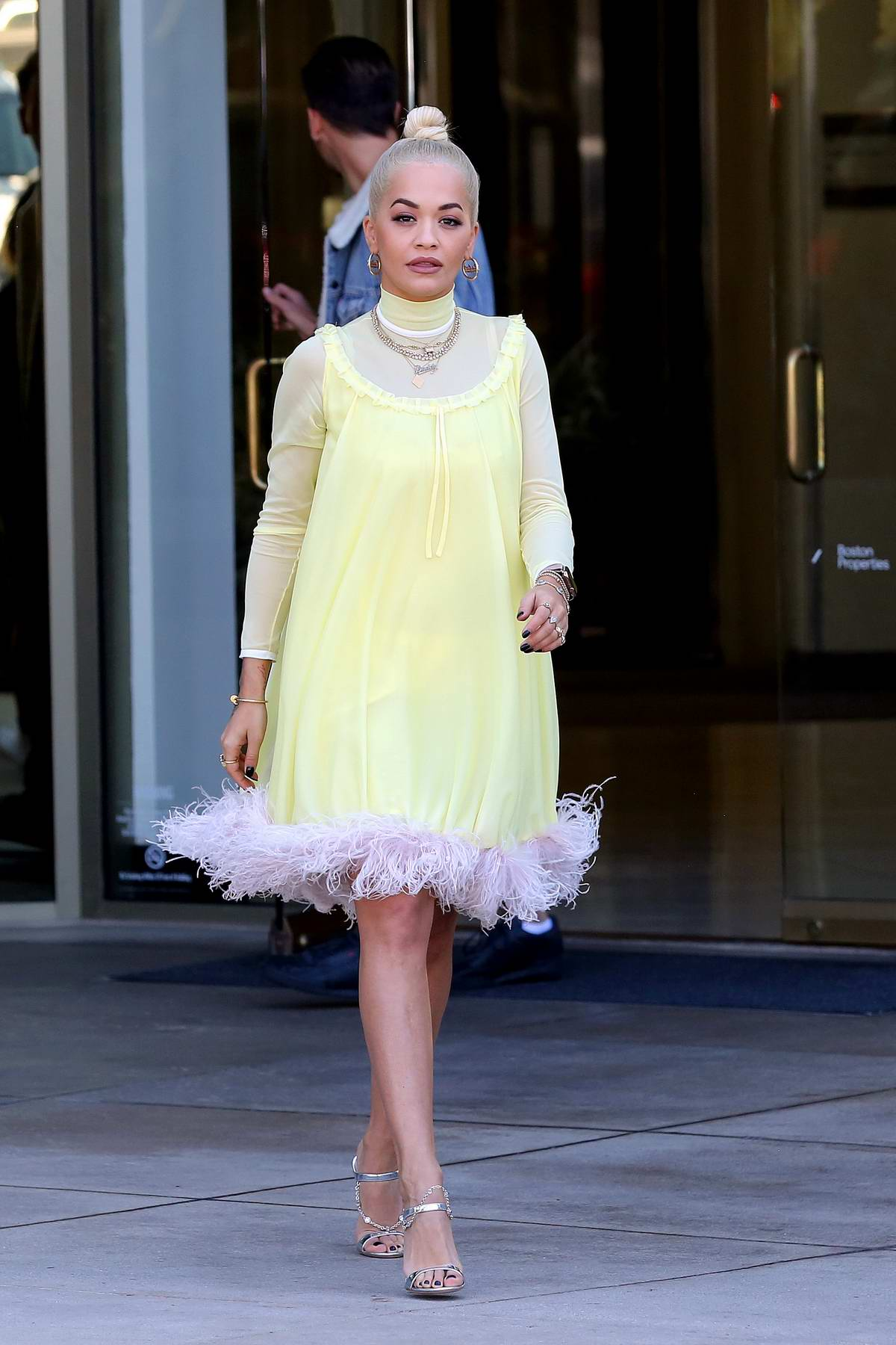 Rita Ora seen wearing a yellow dress with a pair of silver heels as she heads out in Los Angeles