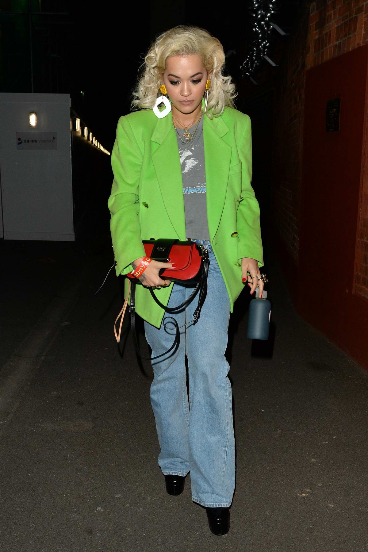 Rita Ora spotted in a bright green blazer and jeans as she leaves Shepherd's Bush Empire in London, UK