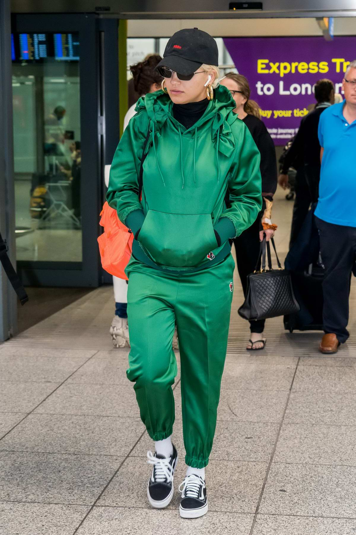 Rita Ora spotted in a green sweatsuit as she touch down at Heathrow airport in London, UK