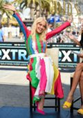 Rita Ora wears a colorful dress as she visits 'EXTRA' at Universal Studios Hollywood in Universal City, California
