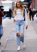Romee Strijd steps out in a white top and ripped jeans in New York City