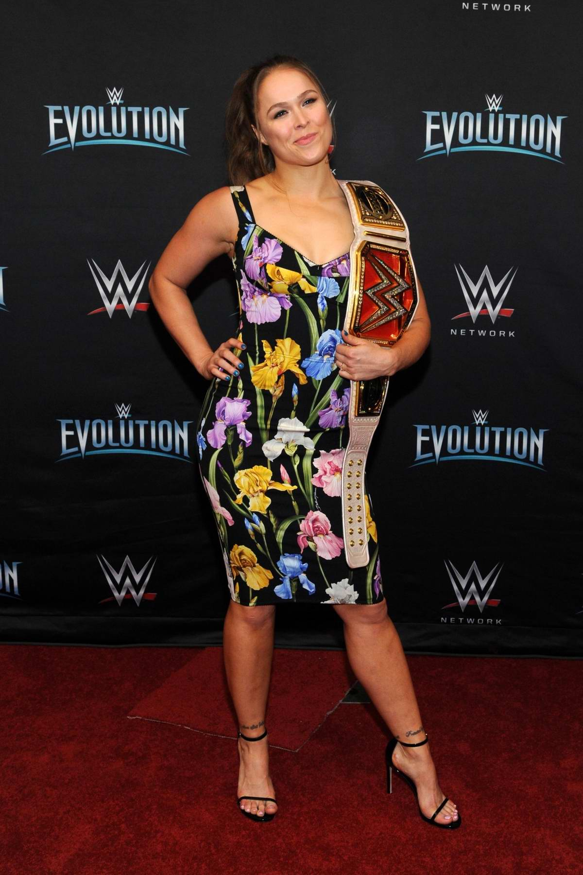 Ronda Rousey attends the WWE's first ever all-women's event 'Evolution' red carpet at the Nassau Veteran's Memorial Coliseum in Uniondale, New York