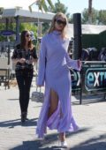 Rosie Huntington-Whitely looks stunning in a purple dress as she films EXTRA TV Live at Universal Studio Hollywood in Universal City, California