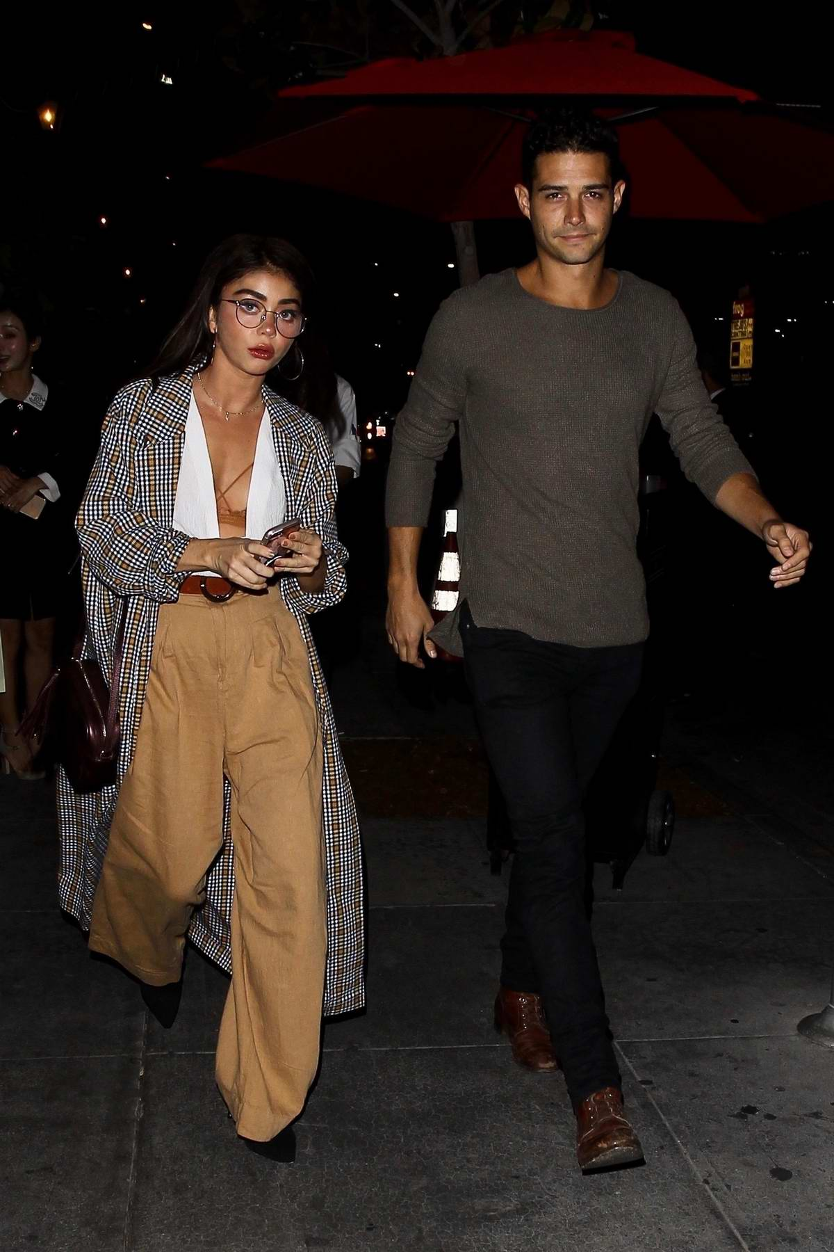 Sarah Hyland and Wells Adams enjoy date night at Beauty & Essex in Hollywood, Los Angeles