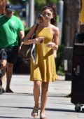 Sarah Hyland steps out in a sleeveless yellow dress while running errands in Los Angeles