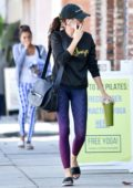 Sarah Hyland wears a black sweatshirt with a colorful leggings while out and about in Los Angeles