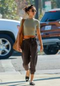 Sarah Hyland wears a grey top and patterned cropped pants as she stops by a nail salon after her workout in Los Angeles