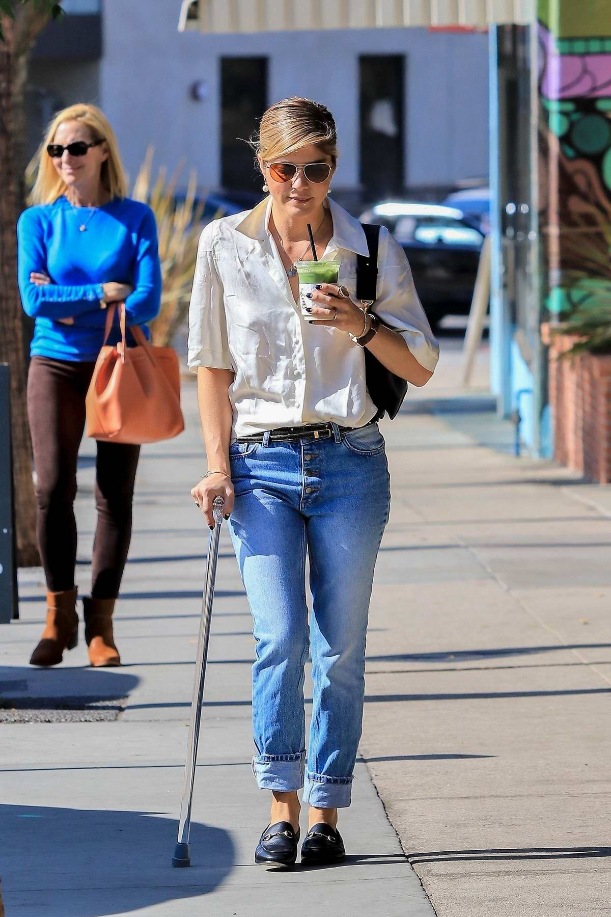 Selma Blair uses a cane following a recent Multiple Sclerosis (MS) diagnosis while out for a green smoothie at Alfred's in Studio City, Los Angeles