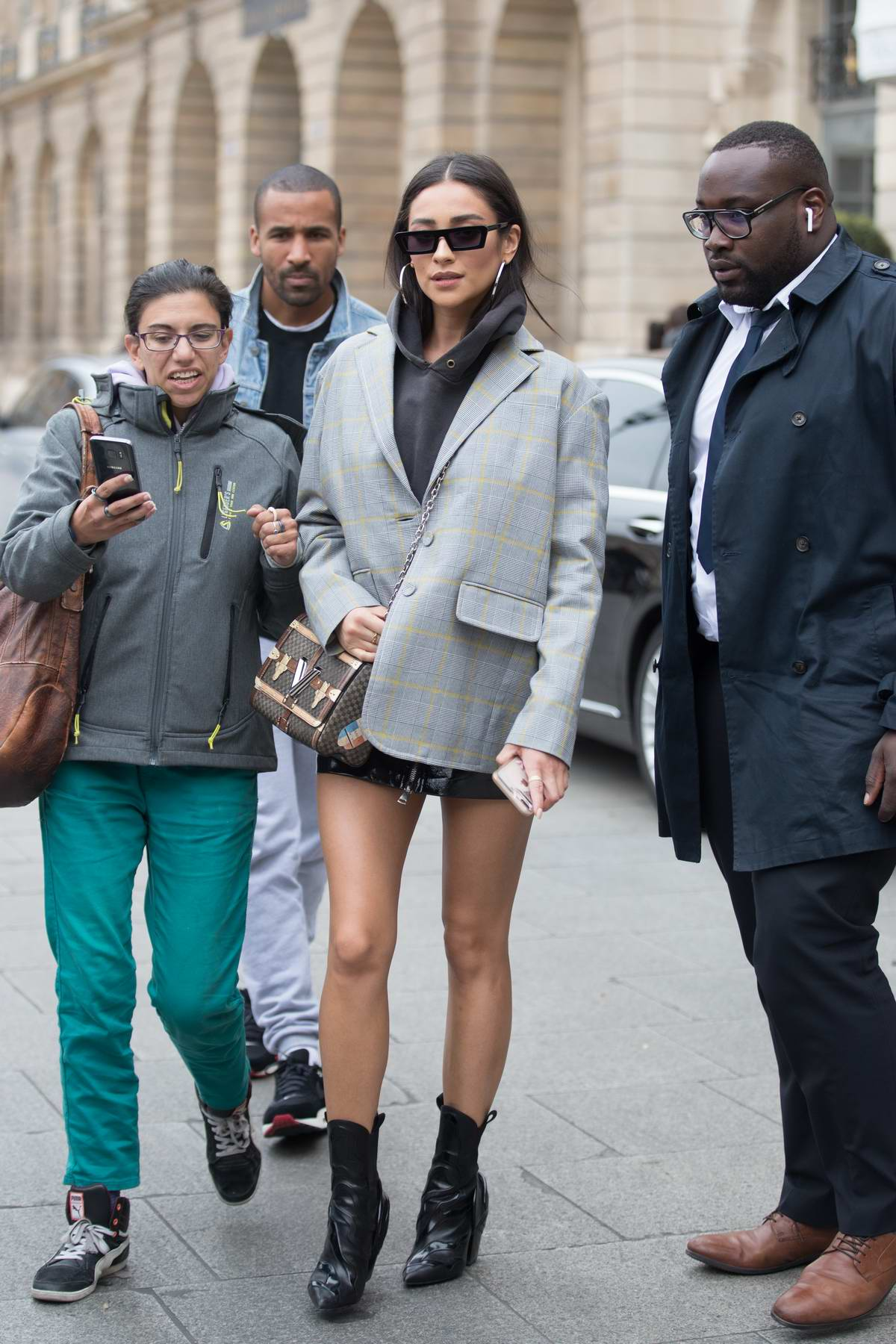 Shay Mitchell looks stylish in a grey blazer as she leaves the Ritz Hotel in Paris, France