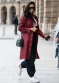 Shay Mitchell seen wearing a Louis Vuitton coat as heads back to her hotel after shopping at Louis Vuitton in Paris, France