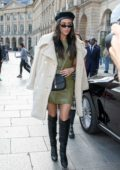 Shay Mitchell steps out of her hotel wearing an olive green Louis Vuitton dress with a beret and knee high boots in Paris, France