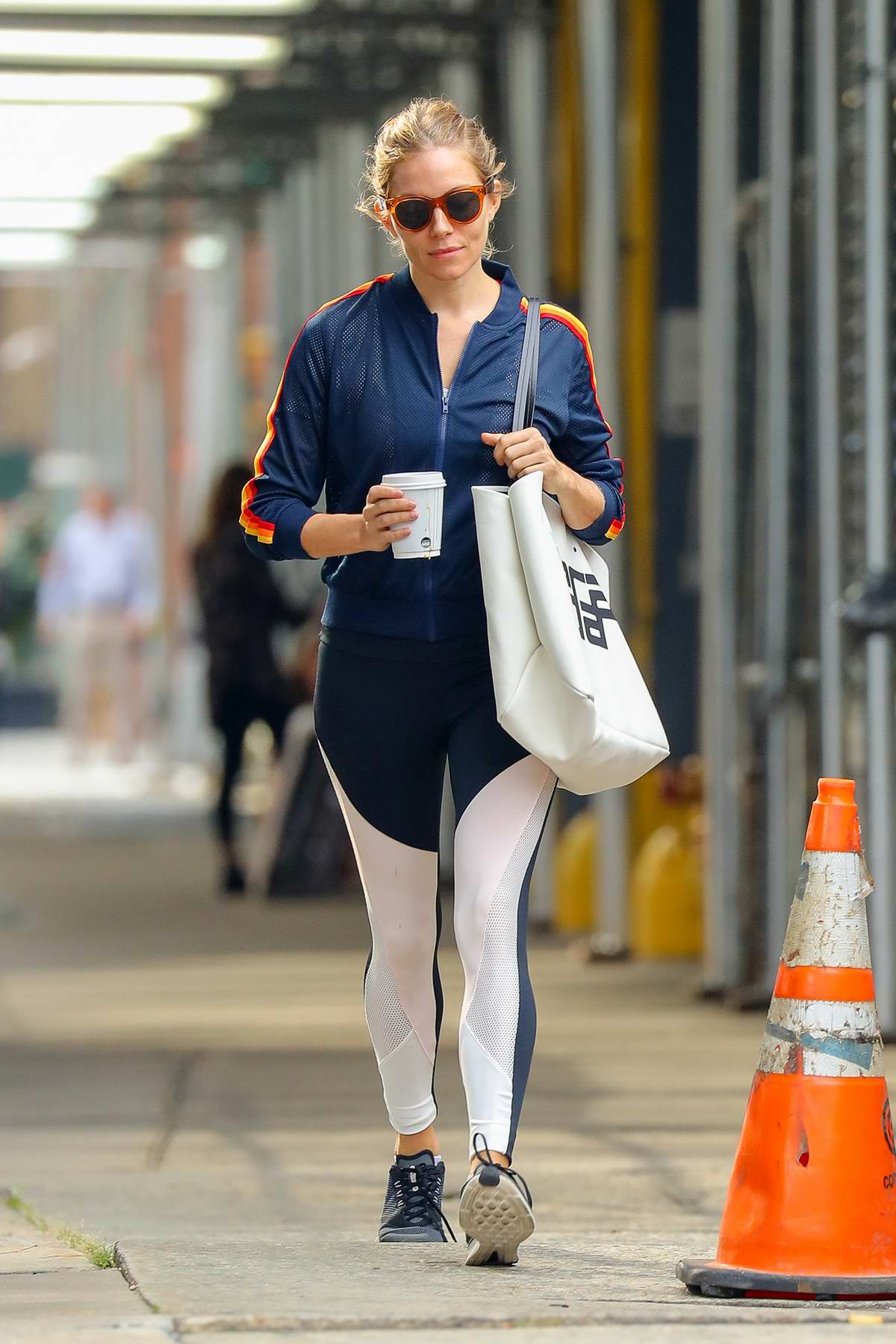 Sienna Miller rocks blue and white activewear while out for her morning coffee in New York City