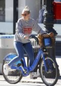 Sienna Miller seen riding a citibike while out running errands in New York City