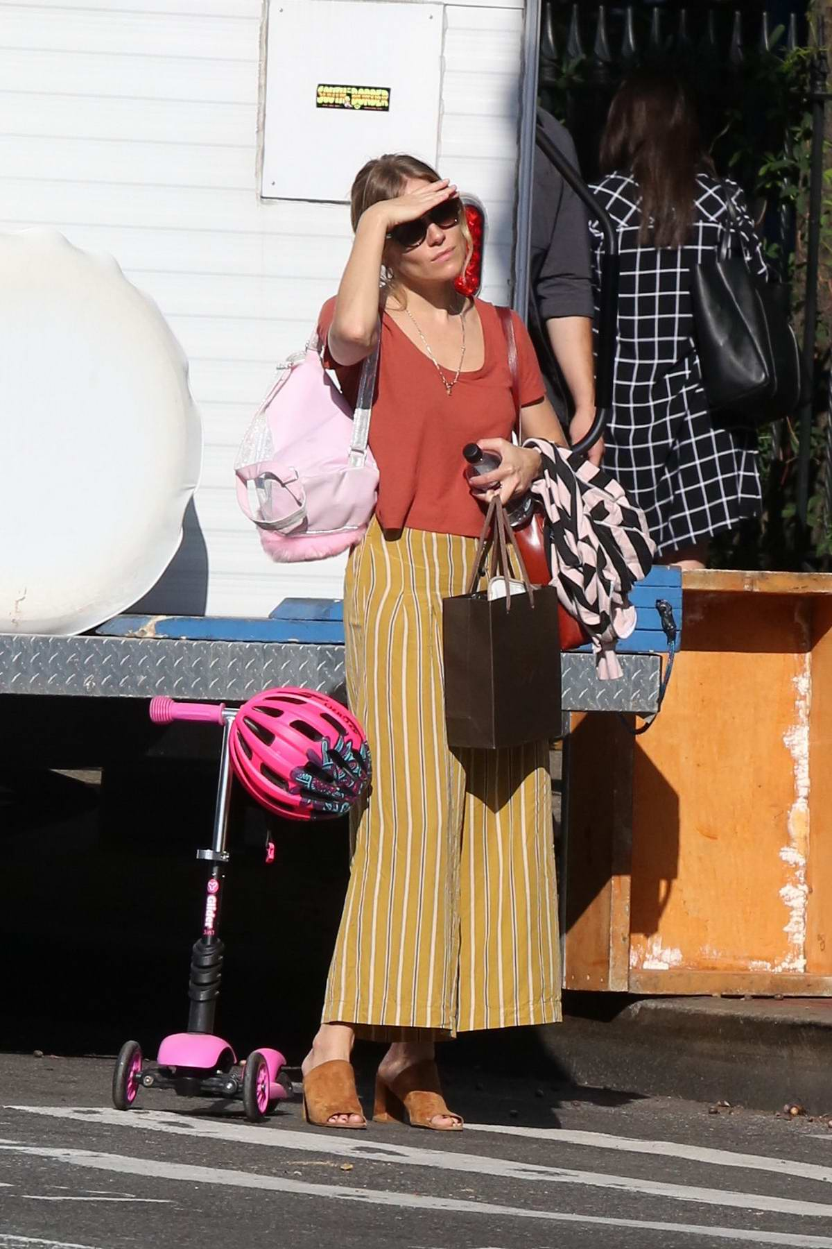 Sienna Miller spotted hailing a cab as she picks up her daughter from school in the West Village, New York City