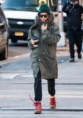 Sienna Miller stays warm in a fur lined green parka while sipping on a hot coffee as she steps out in New York City
