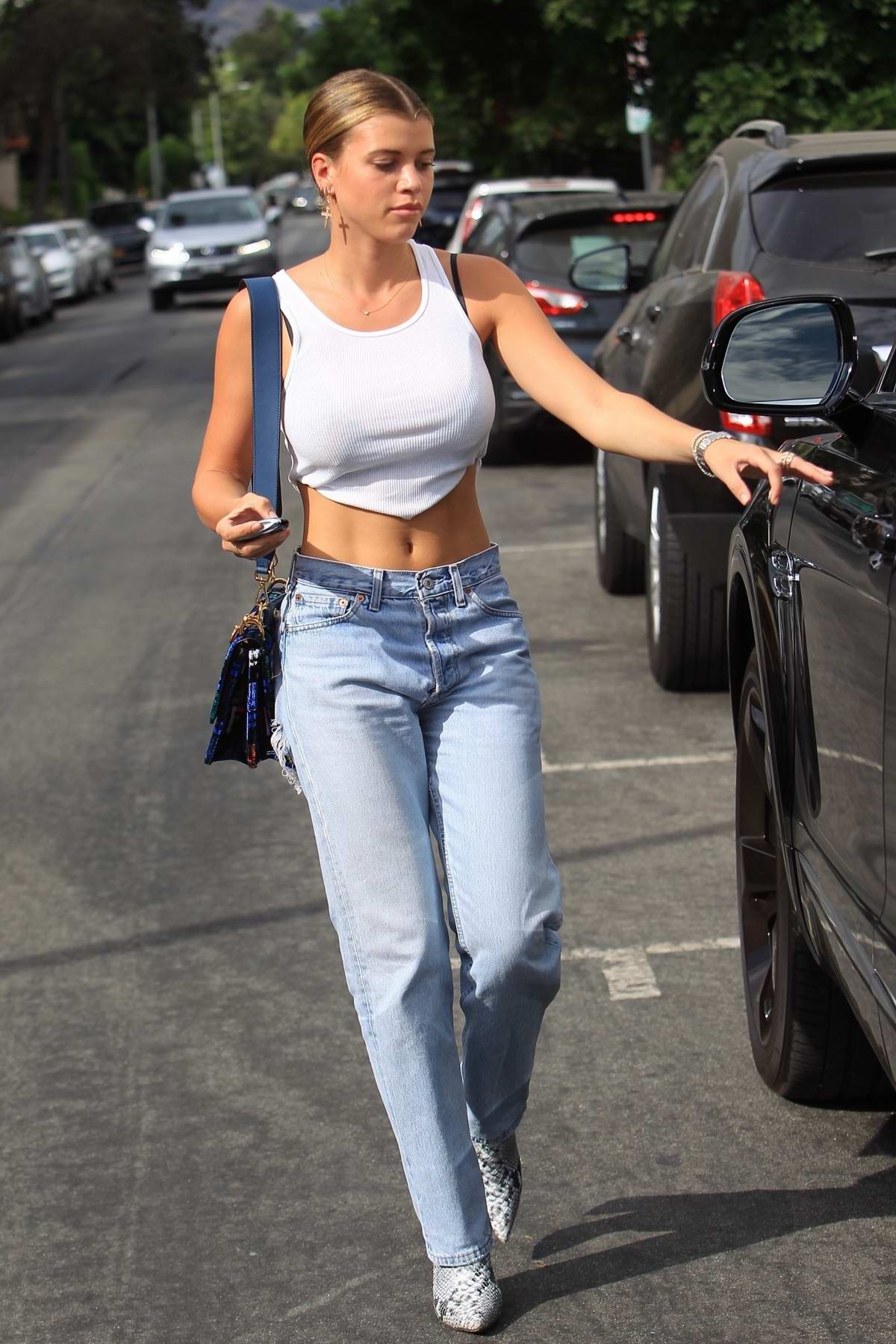 Sofia Richie spotted in a cropped white tank top and jeans while out for shopping in Hollywood, Los Angeles