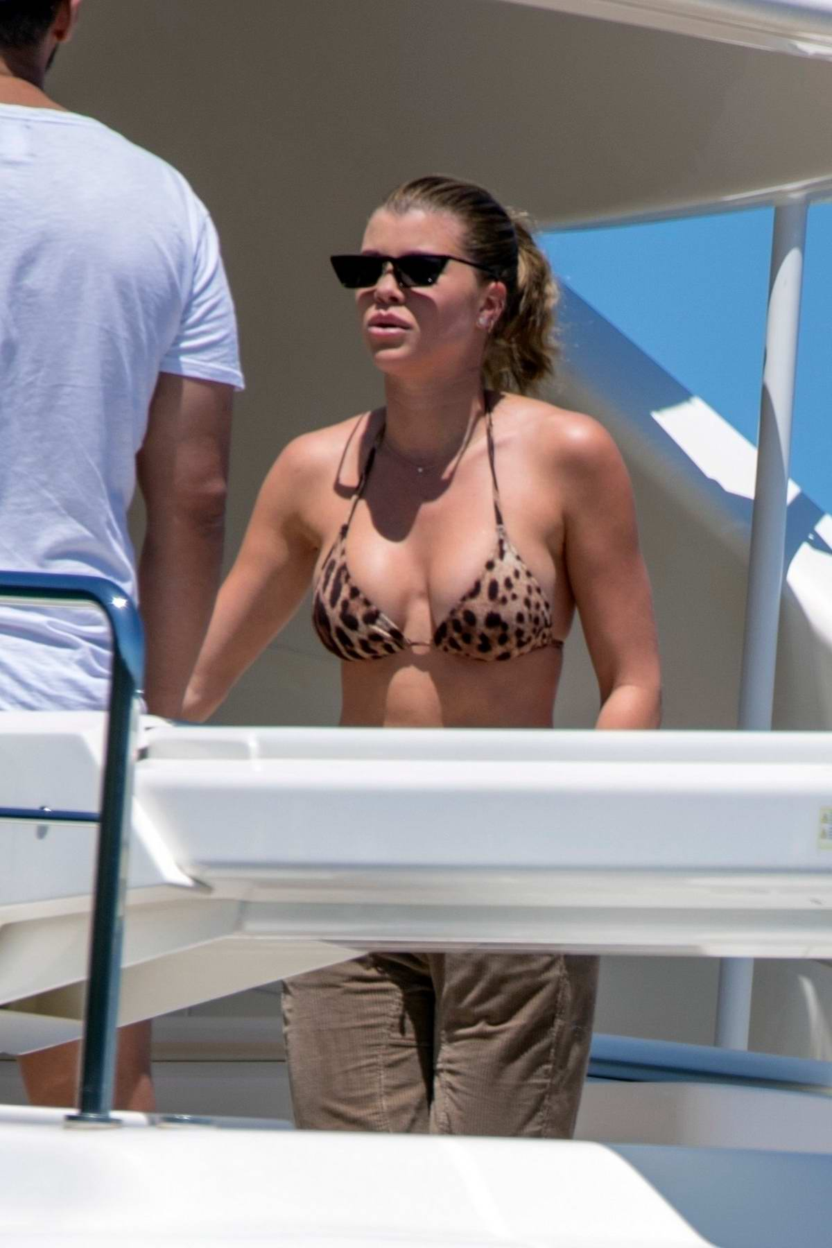 sofia richie spotted in a leopard print bikini on a luxury yacht with Scott Disick in Sydney, Australia