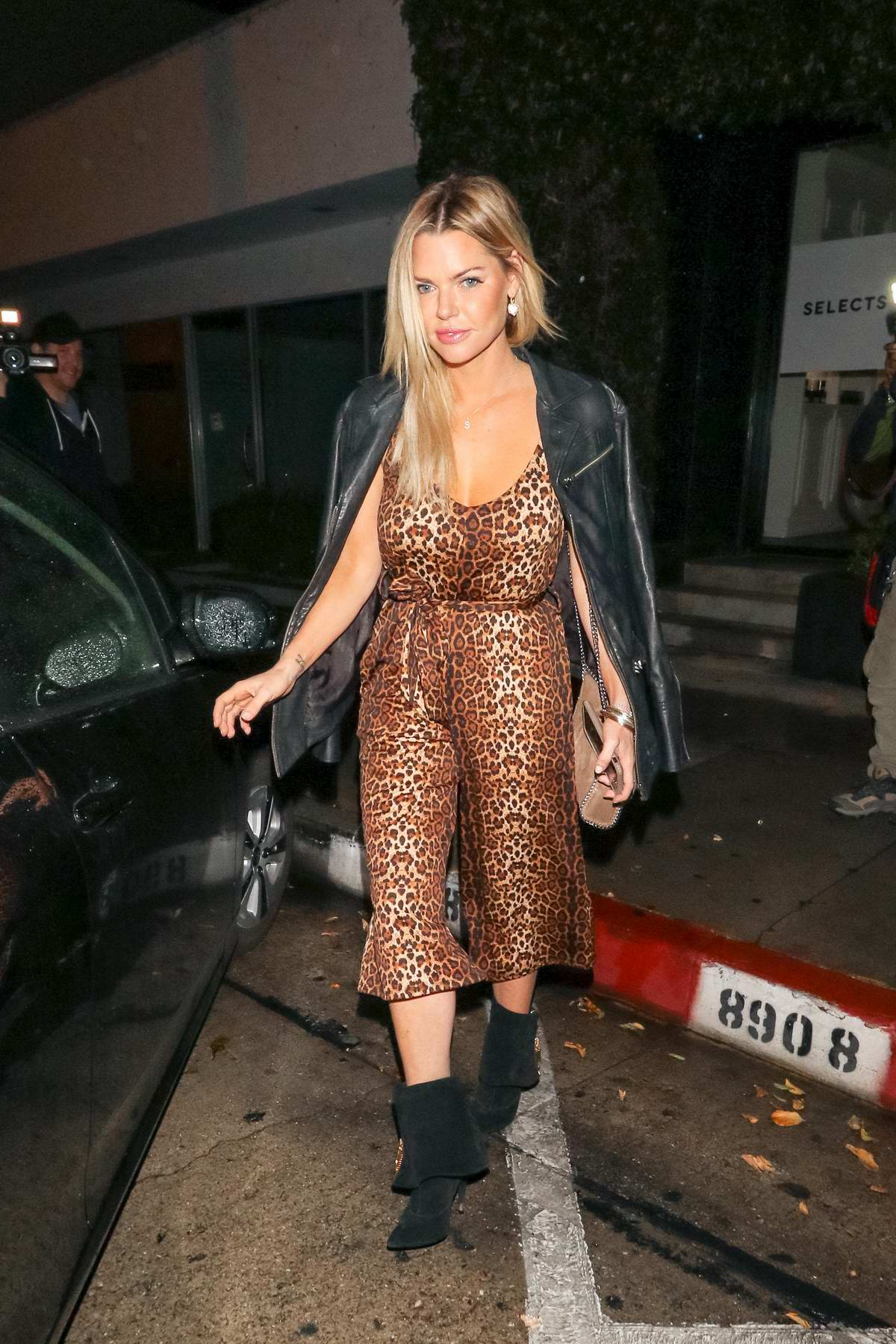 Sophie Monk wore a leopard print jumpsuit during a night out at Craig's in West Hollywood, Los Angeles