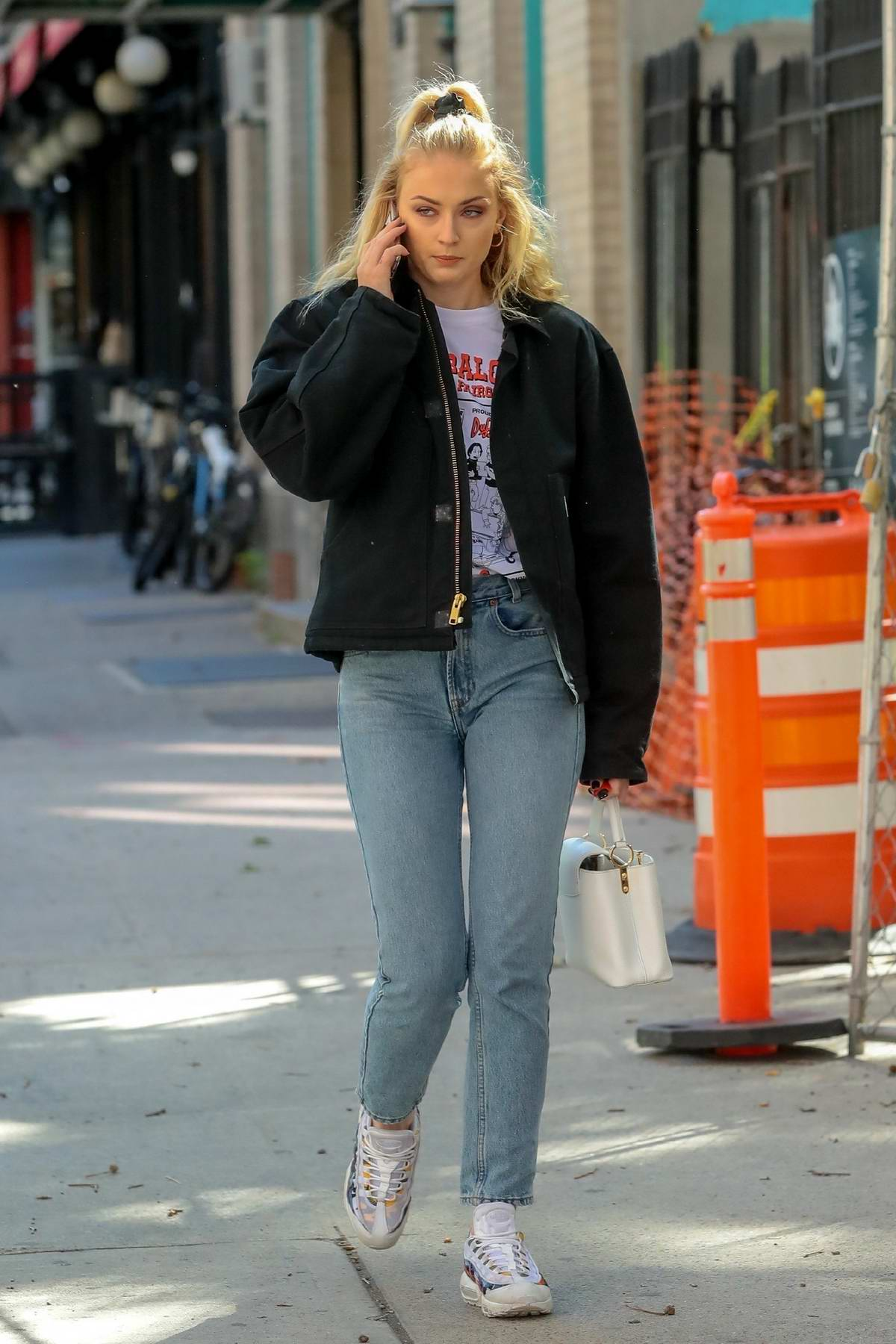 Sophie Turner chats on her phone while out in New York City